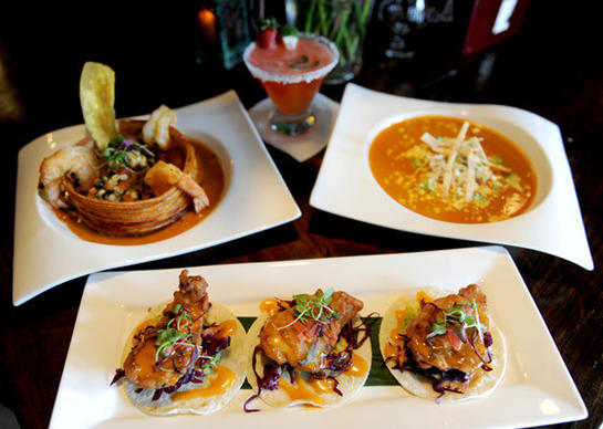 Crispy Mahi Mahi, Seared Shrimp and Scallops, Chicken Tortilla Soup and a Strawberry, Jalapeno Margarita are served at Mesa, a modern Mexican restaurant in Easton.