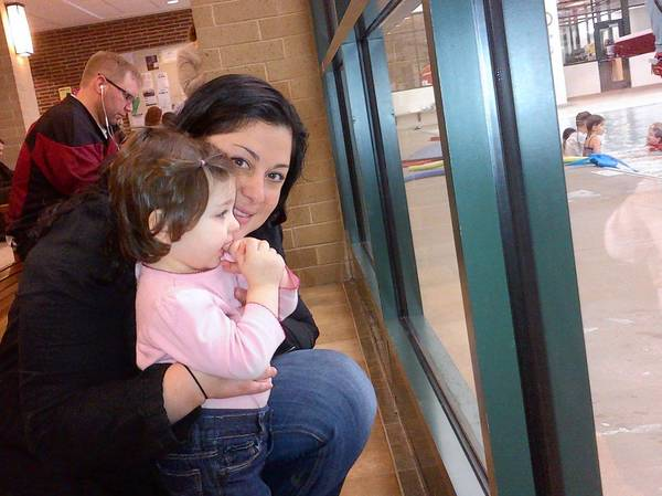 Erin Chimento shows her daughter Liliana the Park Center swimming pool at The Glenview Resident Open House.
