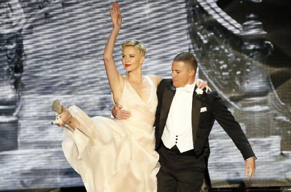 Channing Tatum and Charlize Theron dance on stage during the 85th Academy Awards ceremony.