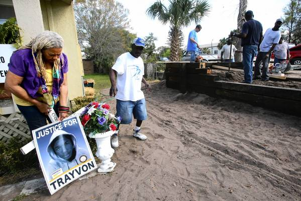 Francis Coleman Oliver, the Historic Goldsboro welcome center and museum director, displays items from the improvised memorial for Trayvon Martin as volunteers construct a permanent memorial in Sanford last week.