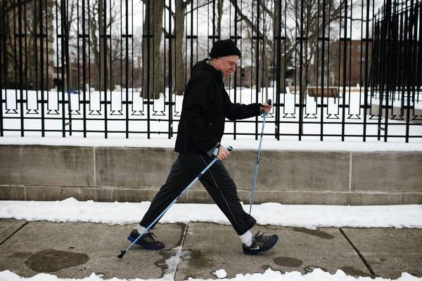 Peter Geraghty, of Oak Park, demonstrates Nordic walking on Home Avenue in Oak Park.