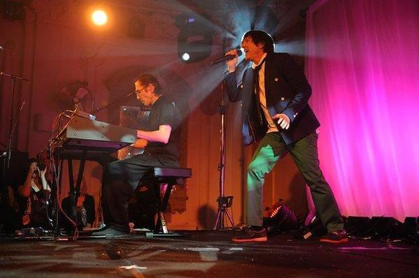 "Ron Mael, left, and Russell Mael perform their ""Two Hands, One Voice"" show."