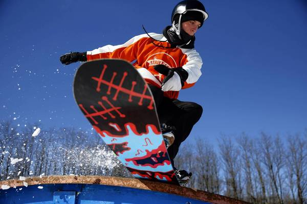Scott Rutherford, 19, of Elgin, rides the rainbow rail at Raging Buffalo Snowboard and Ski Park in Algonquin. With winter and snow-related activities come injuries, the most common in snowboarding a broken wrist. Raging Buffalo's owner, Keith Duck, says one of the best ways to prevent breaking your wrist is to make your hands into fists as you fall.