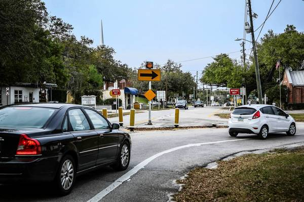 Traffic loops around the original Oviedo Fire Station and Memorial Building, which will soon be removed to accommodate a road straightening project in Oviedo.