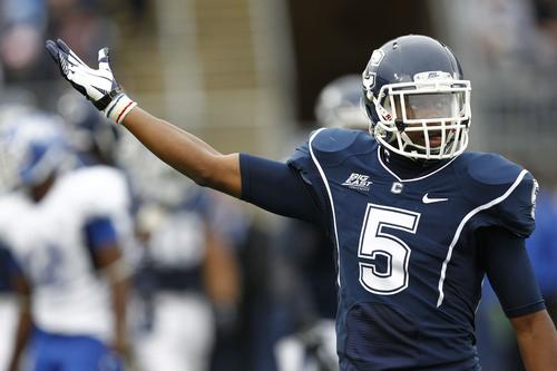 Cornerback Blidi Wreh-Wilson (5) gestures to the crowd during the second half of a game against the Buffalo Bulls at Rentschler Field.