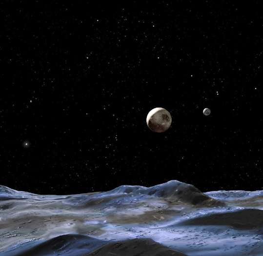 This artists' rendering from NASA depicts how Pluto might look from the surface of one its three bigger moons. The two smallest moons may be named Vulcan and Kerberos.