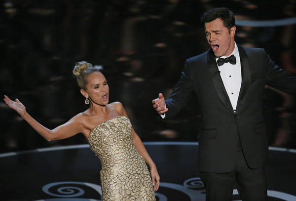Kristin Chenoweth and Seth MacFarlane belt one out for the night's losers at the end of the 85th Academy Awards telecast on Sunday in Hollywood.