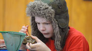 Sixth-graders from West Middle School in Carroll County scoured the Bear Branch stream one recent morning in search of aquatic life in the dead of winter. Nathan Grella said the contents of his bucket did not appear promising.