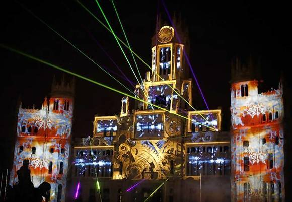 Images are projected on the facade of city hall during a lighting show to mark the start of Christmas festivities in Madrid