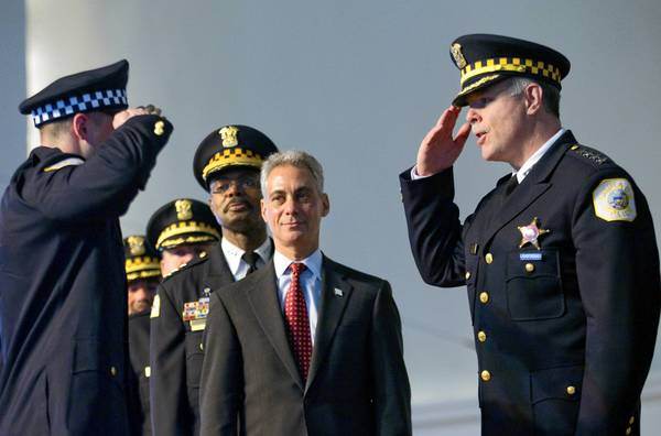 Mayor Rahm Emanuel joins Chicago police Superintendent Garry McCarthy, right, in recognizing graduating police officers at the Navy Pier ballroom last week. The mayor said Monday that he supports McCarthy's efforts despite complaints from some aldermen fed up with the department's inability to control violence in certain neighborhoods.