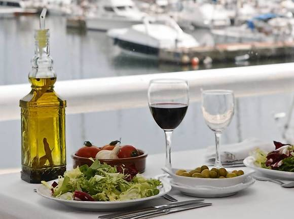 Food is seen on a table at a restaurant at the port of El Masnou