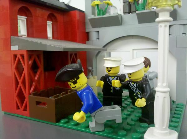 A Lego diorama of police chasing a pirate