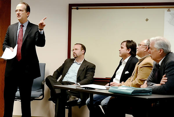 Attorney D. Bruce Poole, left, speaks to those gathered for a meeting with the Economic Development Commission and others at a meeting in the  Washington County Commissioners conference room on Monday.  Listening in is Rob Hobson, Tom Fore, Tim Elliott and Dane Bauer, all representatives of the SORA Group.