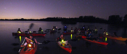 """Under a moonless nighttime sky, people experience a kayak tour looking to witness """"bioluminescent """" waters of the Indian River. """"A Day Away Kayak Tours"""" took 44 people paddling on a unique type of tour. This could lead to a surge in Brevard County's eco-tourism, local boosters say, and help shore up an economy battered by the loss of space-shuttle jobs."""