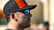 SARASOTA, Fla. — Travis Ishikawa doesn't remember getting hit square in the right cheek, only the glance of a fastball speeding at his head, then waking up on the ground thinking his jaw was shattered.