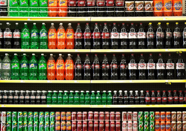 Soft drinks are displayed on the shelf at a grocery store. A California lawmaker wants to impose a tax on sweetened beverages.