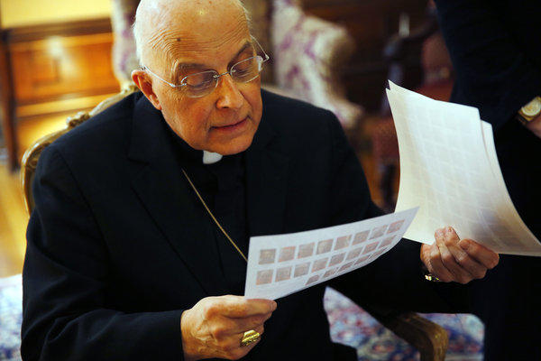 Chicago Cardinal Francis George today looks over papers showing Roman Catholic cardinals during a discussion with the Tribune at Georges residence before his departure for the conclave to elect a new pope.