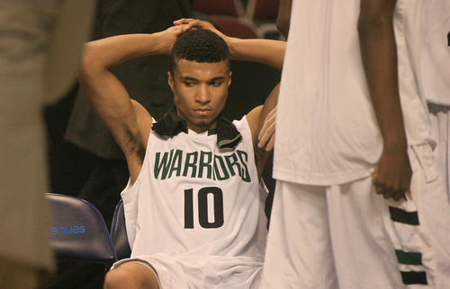 Kecoughtan's Lawrence Williams shows his disappointment following the Warriors' 64-55 loss to Great Bridge in Monday's Eastern Region final.