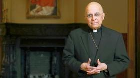 Cardinal George heads to Rome to elect new pope