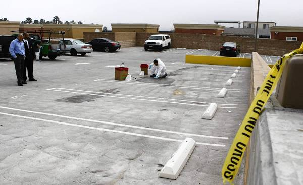 The crime scene on the top floor of a parking garage in Irvine, where Monica Quan and Keith Lawrence were slain.