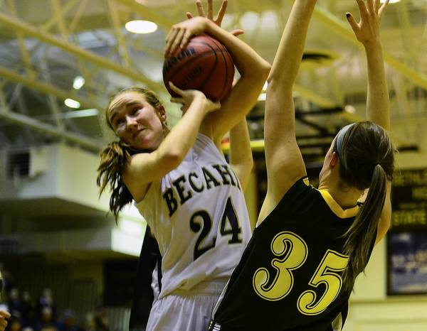 Bethlehem Catholic's Bridget Smith (24) grabs a rebound in front of Central Catholic's Jackie Fronheiser during an LVC game in January.