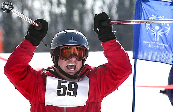 Paul Howard of Carroll County celebrates after crossing the finish line in the alpine skiing event during the 2013 Special Olympics Maryland Winter Games at Whitetail Resort Monday.