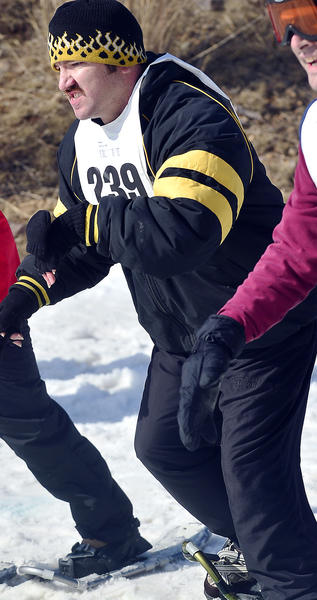 Lee Follett represents Washington County in the 400-meter snowshoe race at the Special Olympics Maryland 2013 Winter Games on Monday at Whitetail Resort.