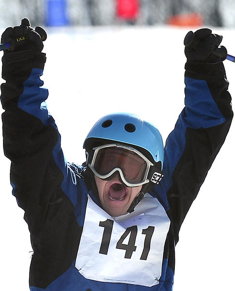 Matthew Loyco of Harford County celebrates after crossing the finish line in the alpine skiing event during the 2013 Special Olympics Maryland Winter Games at Whitetail Resort Monday.