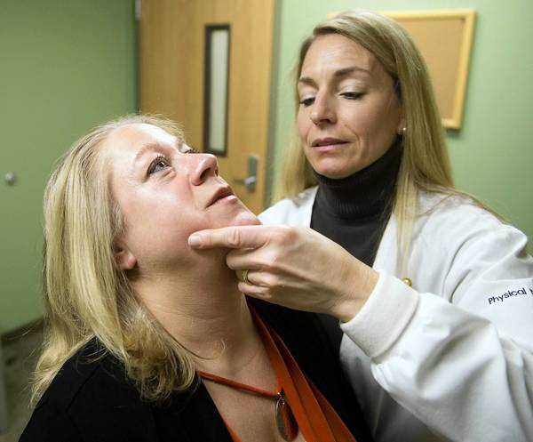 A new form of therapy is helping people to control chronic headaches without medication. Alicia Shoup, physical therapist, works with patient Donna Brown of South Whitehall at Good Shepherd CedarPointe in Allentown.