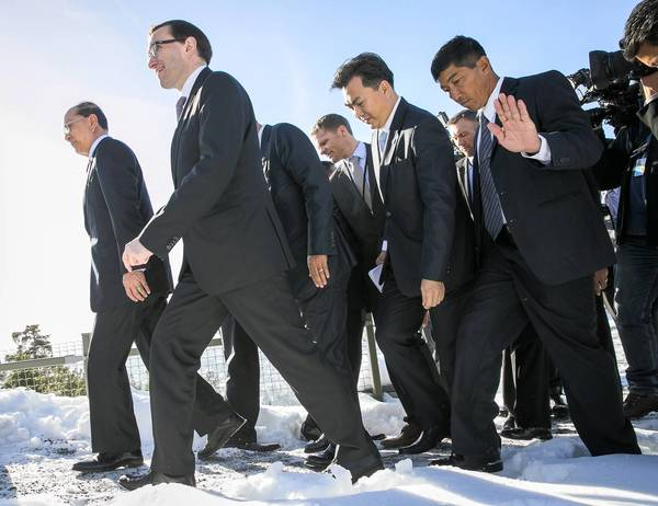 Myanmar President Thein Sein, left, Norway`s Minister of Foreign Affairs, Espen Barth Eide, second left, followed by their delegations, walk through the snow before their meeting in Oslo. President Sein arrived in Oslo, kicking off his first trip to Europe aimed at forging stronger ties between the former pariah state and the West.