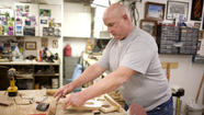 Blind man continues to build furniture