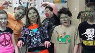 PELLSTON -- Pellston Middle School students in the 21st Century program survived an invasion of zombies -- at least they did in the movie they created as part of Crooked Tree Arts Center instructor Jim Tisdel's video arts class.