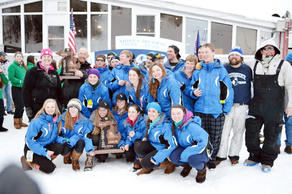 The Petoskey High School boys and girls ski team celebrate their respective Division II state skiing titles Monday at Marquette Mountain. It was the second time in the past three seasons the Northmen swept both the boys and girls state titles.