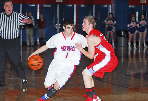 West Jessamine's Will Henderson uses some real hands-on defense on Timmy Taylor of Lincoln as Taylor brings the ball upcourt Monday night.
