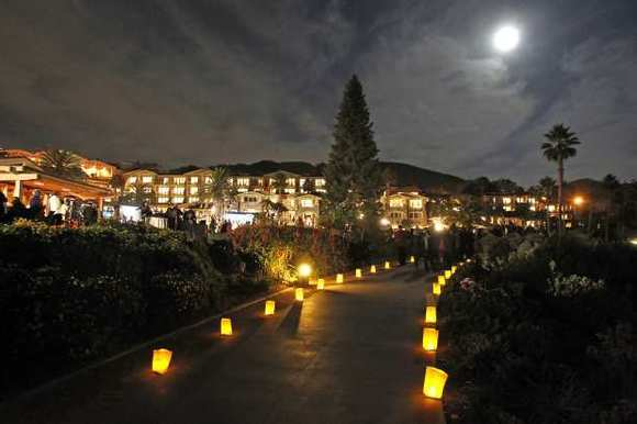 Luminaries light the pathways along with a bright moon during the Montage Resort's Christmas tree lighting ceremony in November.