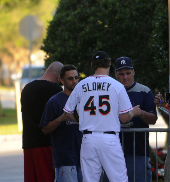 Miami Marlins  pitcher Kevin Slowey signs autographs during Marlins Media Day Friday.