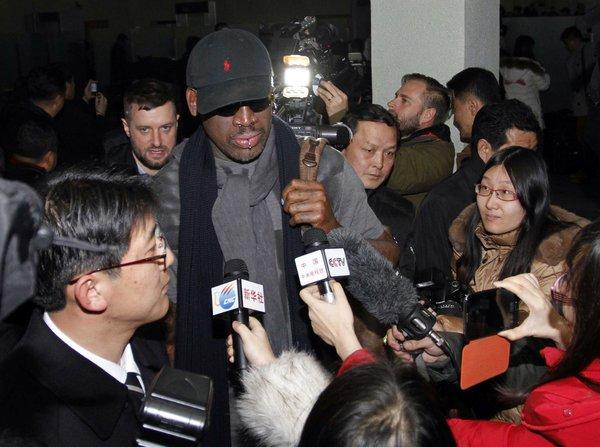 Dennis Rodman is surrounded by journalists upon his arrival at Pyongyang Airport in North Korea on Tuesday.