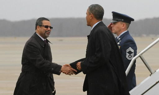 Newport News Mayor McKinley L. Price, left, greets President Obama at Langley Air Force Base.