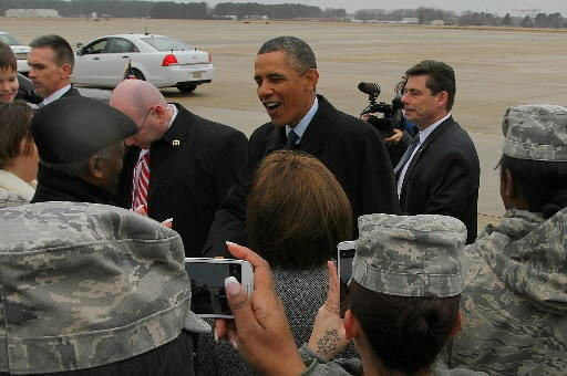 President Barack Obama greets the public and service members just after landing at Langley Air Force Base in Hampton on Tuesday.