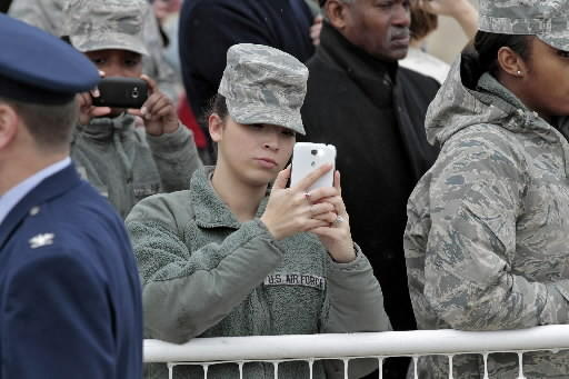 Military personnel take photographs of President Obama arriving at Langley Air Force Base in Hampton Tuesday morning.