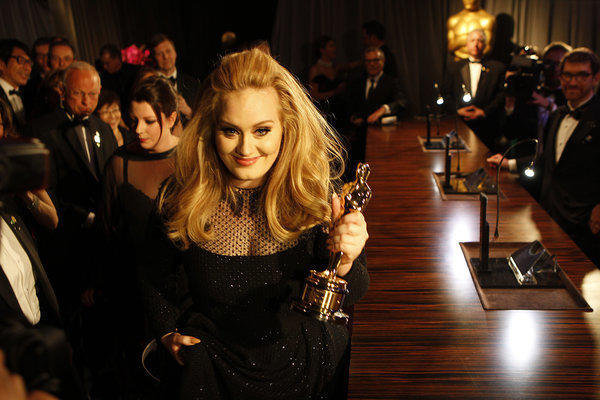 "British soul singer Adele, shown with her best-song Oscar from the Academy Awards, had the world's best-selling album of 2012 with ""21."""