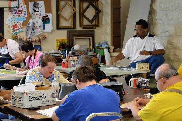 Artists paint during a recent studio session at the Garden Gallery and Studio in Tinley Park, where some 35 adults with a variety of developmental disabilities create art. Their work fills the studio space in Tinley Park's Historic District on Oak Park Avenue.