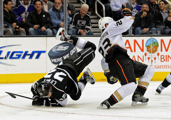 Los Angeles Kings center Trevor Lewis (22) is hip checked by Anaheim Ducks defenseman Francois Beauchemin (23) in the third period of the game at the Staples Center. Kings won 5-2.