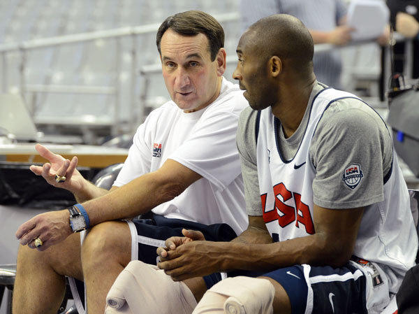 USA head coach Mike Krzyzewski (left) talks with guard Kobe Bryant (right) during practice in preparation for the 2012 London Olympic Games at Palau Sant Jordi.