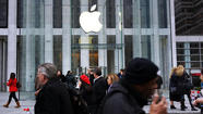 Apple to hand out $100 million in iTunes credits to settle lawsuit