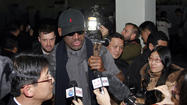 "It's a story so strange it could have been cobbled together through Mad Libs: Flamboyant basketball star Dennis Rodman and some of the showy Harlem Globetrotters arrived Tuesday in the isolated country of North Korea, in a filmed trip billed as ""basketball diplomacy."""