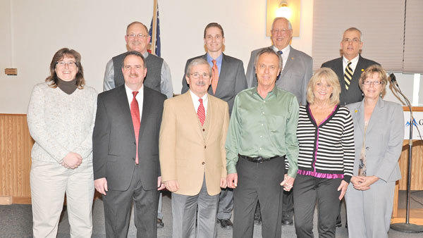 The annual Gaylord Area Chamber of Commerce award winners are pictured (front row, l-r): Melissa FitzGerald, Otsego County Animal Control director (Bell Tower Award), Matt Barresi, Gaylord Regional Airport director (Chamber Volunteer of the Year), Jack Thompson, University Center Gaylord director (Daune Weiss Businessperson of the Year), Bob Webster, owner, Thrifty Print (Golden Pineapple Award), Pat Webster, owner Thrifty Print (Golden Pineapple Award), Karen McCaffrey, Northwestern Bank (Chamber Ambassador of the Year); (back row, l-r): Mike Tarbutton, Otsego County Parks and Recreation director (You Made it Happen Award), John Burt, Otsego County administrator (You Made it Happen Award, Bell Tower Award), Ed Doss (Chairmans Award) and Tim Hall, Northwestern Bank (Golden Pineapple Award).