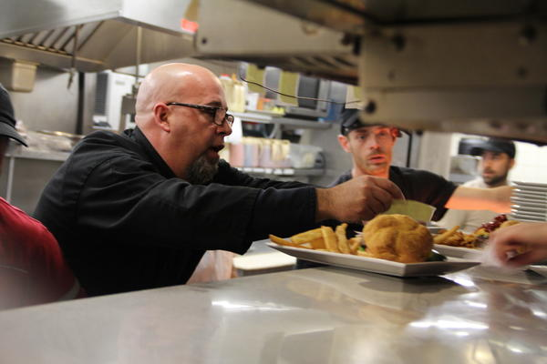Employees of TD Homer's Grill, 461 Queen St., Southington, prepare gourmet burgers during the restaurants Free Gourmet Burger Day on Tuesday, Feb. 26.