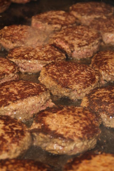 Half-pound beef patties sizzle on the grill at TD Homer's, 461 Queen St., Southington, Tuesday, Feb. 26 during the restaurants Free Gourmet Burger Day. The restaurant prepared over 2,000 beef patties for the day.