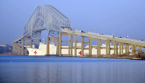 The Baltimore-based hospital ship USNS Comfort passes under the Francis Scott Key Bridge as it sails on a new mission to Central and South America and the Caribbean. Continuing Promise 2011 is a five-month humanitarian mission to nine countries that will provide medical, dental, veterinarian and engineering assistance to the host nations.